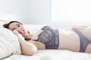 brunette girl in underwear. beauty girl in the bed