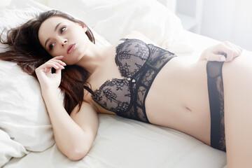 brunette girl in underwear.beauty girl in the bed