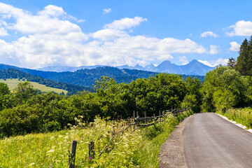 Cycling road from Osturnia to Kacwin village in Tatra Mountains on Poland Slovakia border on beautiful summer sunny day