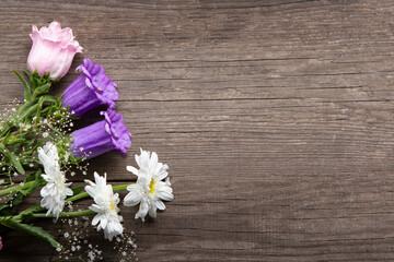 Wild flowers bouquet on wooden background