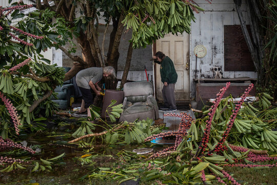 Couple clear debris from destroyed home in aftermath of Hurricane Hanna in Port Mansfield, Texas