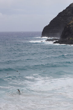 Surfers take to the waves at Makapuu Beach in Waimanalo