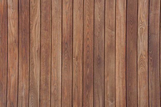 Rich colored clean dark wooden vertical panel slats background with even lighting.