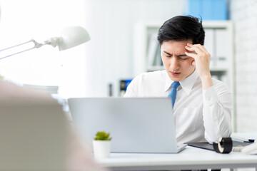 businessman has headache in office