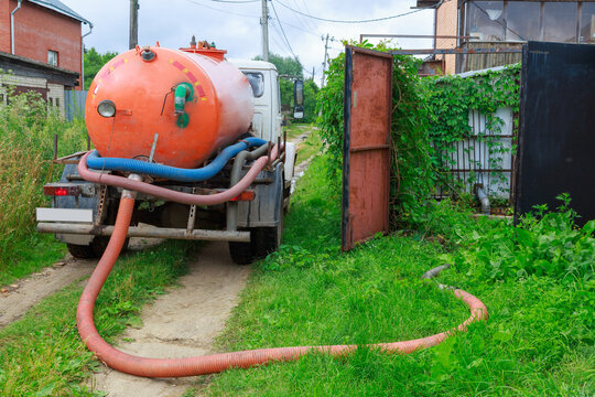 A Sewage truck working in village environment