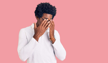 Handsome african american man with afro hair wearing casual clothes and glasses rubbing eyes for fatigue and headache, sleepy and tired expression. vision problem