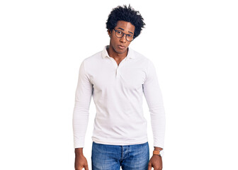 Handsome african american man with afro hair wearing casual clothes and glasses skeptic and nervous, frowning upset because of problem. negative person.