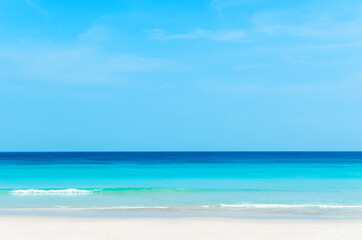 Wall Mural - Beautiful tropical beach with blue sky and white clouds abstract texture background. Copy space of summer vacation and holiday business travel concept.