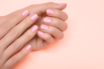 Printed roller blinds Manicure Female hands with pink nail design. Pink nail polish manicured hands. Female hands on pink background.