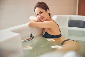 Cheerful good-looking woman enjoying her spa procedure