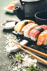 Canvas Prints Countryside Closeup of fresh sushi on rustic wooden table