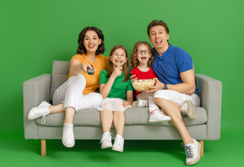 Happy loving family on bright color background.
