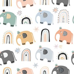 Scandinavian baby seamless pattern with cute elephants and rainbows, pastel color
