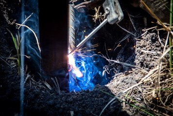 Sparks from welding at a construction site.