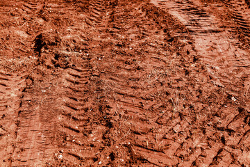 Traces of a truck on red soil.