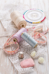 Assortment of sewing accessories on white background