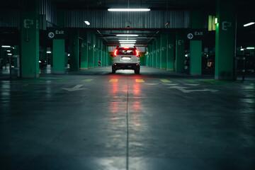 white suv car at underground parking Fototapete