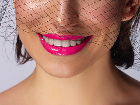 Sexual full lips. Natural gloss of lips and woman's skin. White teeth. Increase in lips, cosmetology. Natural lips. Great summer mood with open mouth. fashion jewelry. Pink lip gloss