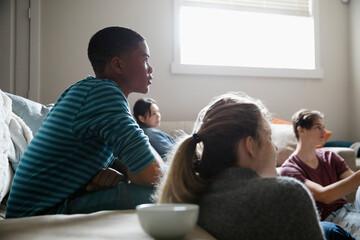 Teenage friends watching TV