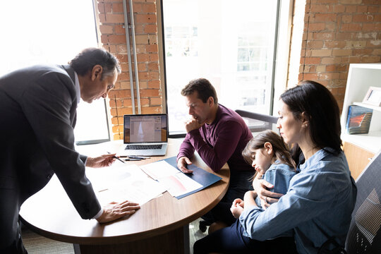 Young family meeting with financial planner in office
