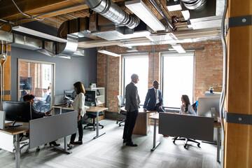 Business people working in open plan office