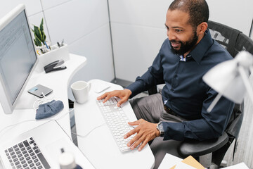 Mature man using computer in office