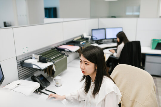 Young Chinese woman working in office