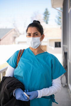 Portrait dedicated female nurse in scrubs and face mask