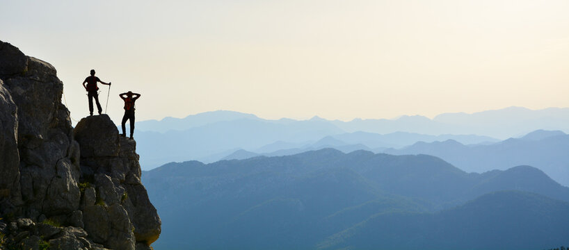 Silhouette of a man on the top of the mountain