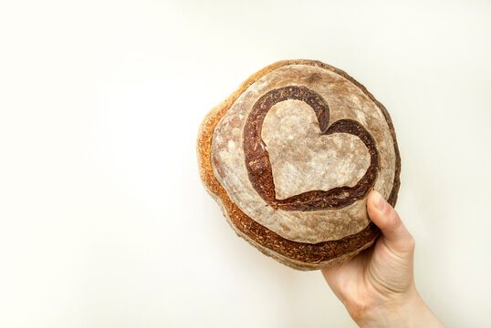 A women's hand holding bread