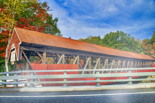 Bartlett wooden covered bridge in New England during foliage season, USA