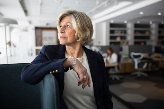 Senior businesswoman looking away in modern office