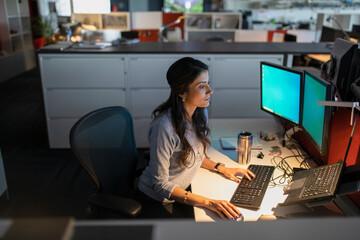 Woman using computer at desk