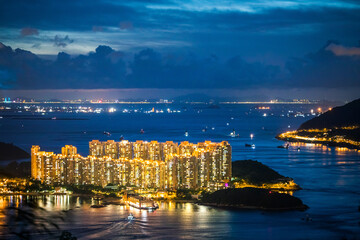 Wall Mural - Epic night view of Ma Wan, West side of Hong Kong, aerial view