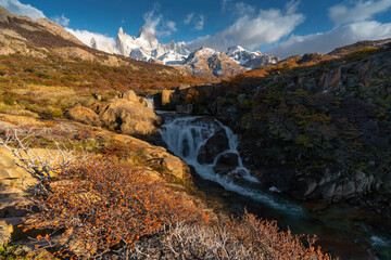 Wall Murals Roe Secret waterfall and white snow cover Fitz Roy Mountain in autumn, Patagonia, Argentina.