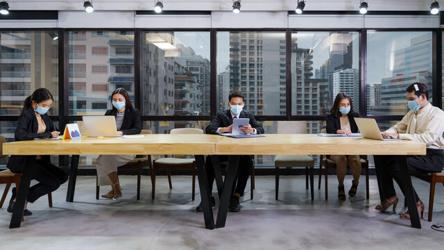 new normal office practise to keep social distance and wearing mask