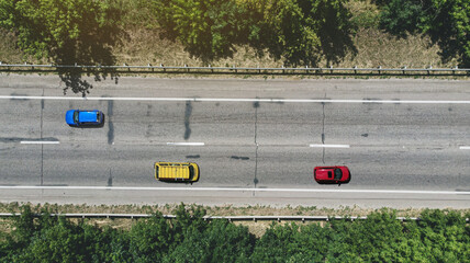Aerial. Cars on the asphalt highway road. Top view from drone.