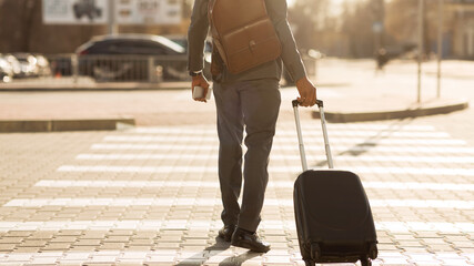Unrecognizable Gentleman With Travel Suitcase Crossing Road Outdoor, Panorama, Rear-View