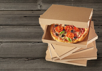 Delicious traditional Italian pizzas in boxes
