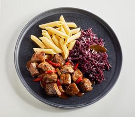 Serving of spicy German ragout or beef goulash