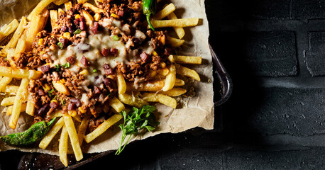 Fried potato chips with beef mince and cheese