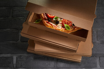 Italian pizza packed ready to go in a box