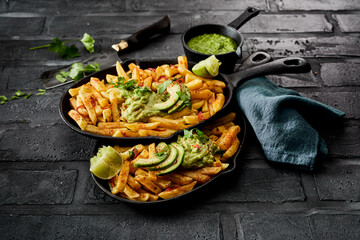 Two skillets with servings of savory potato chips