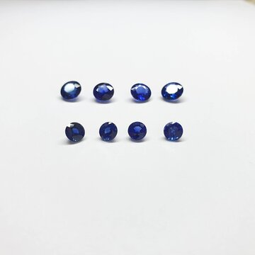 Natural Blue sapphire loose stone on white paper background. Gemstone concept