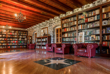 Budva, Montenegro - May 30, 2019: Wood and brick interior of the library inside the 15th century Citadel in the well preserved medieval Old town