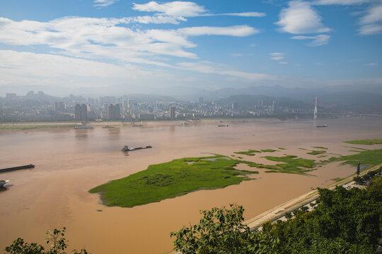 A vast chinese city looks onto the river Yangtze