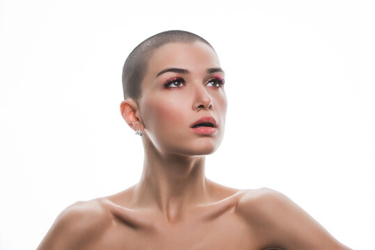 Modern beauty portrait. Young woman with shaved head