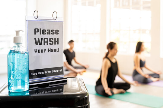 Hand sanitizer at yoga class fitness centre