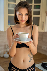 brunette woman in lingerie at home in the kitchen