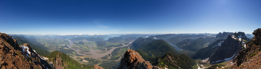 Panoramic View of Fraser Valley from top of Mountain, Cheam Peak, during a sunny summer morning. Taken near Chilliwack, East of Vancouver, British Columbia, Canada. Nature Background Panorama